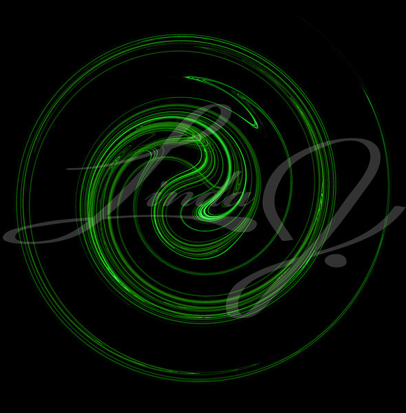 The motion of something green spiraling or swirling on a black background.