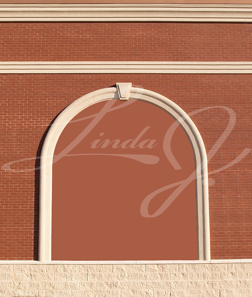 Ornate Roman styled brick wall with curved molding and a brick colored copy space.