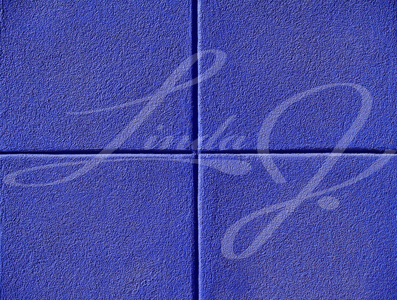 Four blue squares on a concrete wall, powerpoint background and copy space.