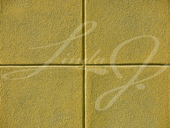 Four yellow squares on a concrete wall, background and copy space.