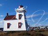 Lighthouse next to a village on Prince Edward Island, Canada, with copy space.