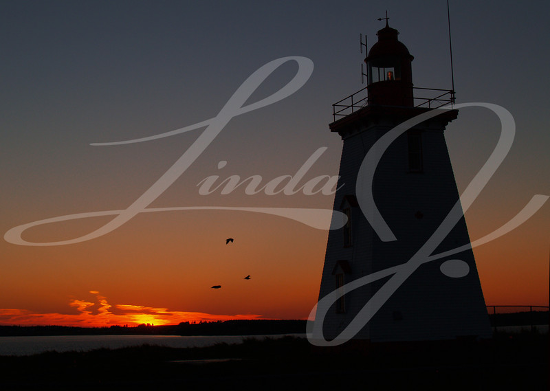 Silhouette of a Lighthouse at sunset on Prince Edward Island, Canada, with copy space.