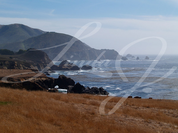 Hazy Days--Rocky coast which boasts a stone arch south of Santa Barbara, California