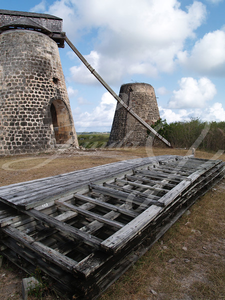 Old windmills behind paddles on Bettys Hope Plantation near Seatons, Pares on Antigua Barbuda in the Caribbean Lesser Antilles West Indies.