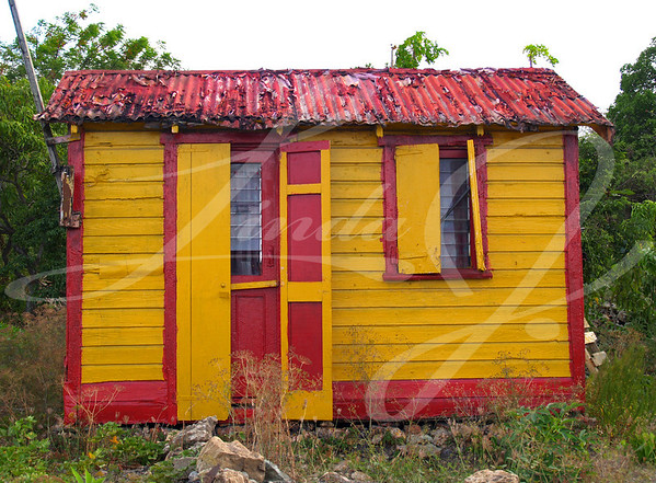 Colorful home in Antigua Barbuda in the Caribbean Lesser Antilles West Indies.