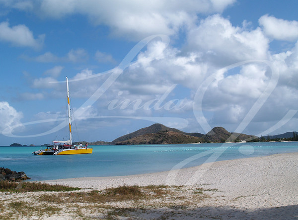 Catamaran off the coast of Jolly beach on Antigua Barbuda in the Caribbean Lesser Antilles West Indies.