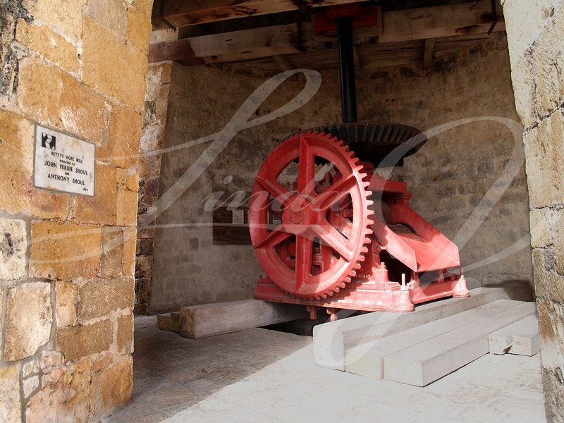Refurbished gears of an old windmill on Bettys Hope Plantation near Seatons, Pares on Antigua Barbuda in the Caribbean Lesser Antilles West Indies.