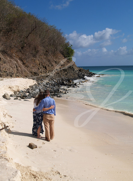 "Couple standing on Frys beach on Antigua Barbuda in the Caribbean Lesser Antilles West Indies.....Contact for model release --put ""model release requested"" in the subject line."