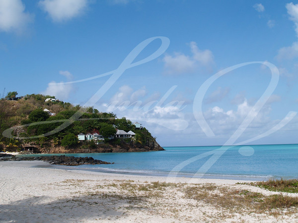 Hotel and cottages near Jolly beach on Antigua Barbuda in the Caribbean Lesser Antilles West Indies.