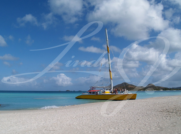 Catamaran at Jolly beach on Antigua Barbuda in the Caribbean Lesser Antilles West Indies.