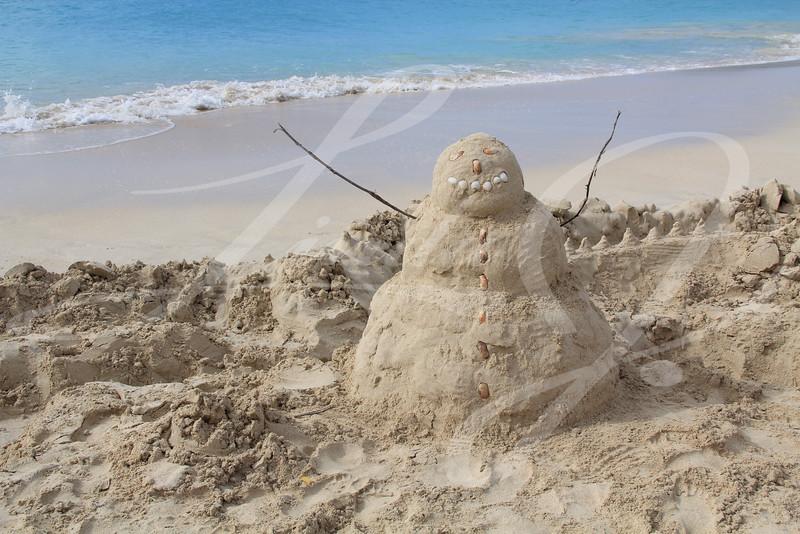 Sandman on a beach in Antigua Barbuda