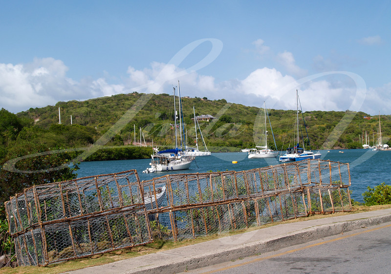 Lobster traps beside English Harbour in Nelsons Dockyard National Park, on Antigua Barbuda in the Caribbean Lesser Antilles West Indies.