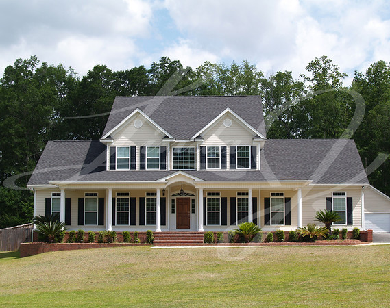 Two story residential home with with board siding on the facade.