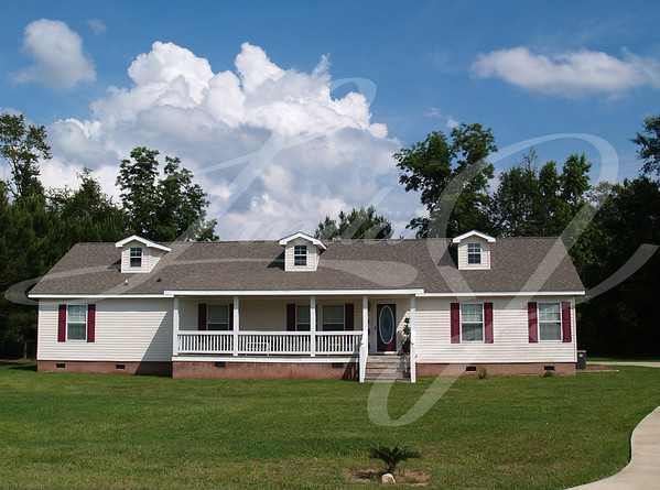 One story residential home with vinyl siding on the facade and a brick foundation.