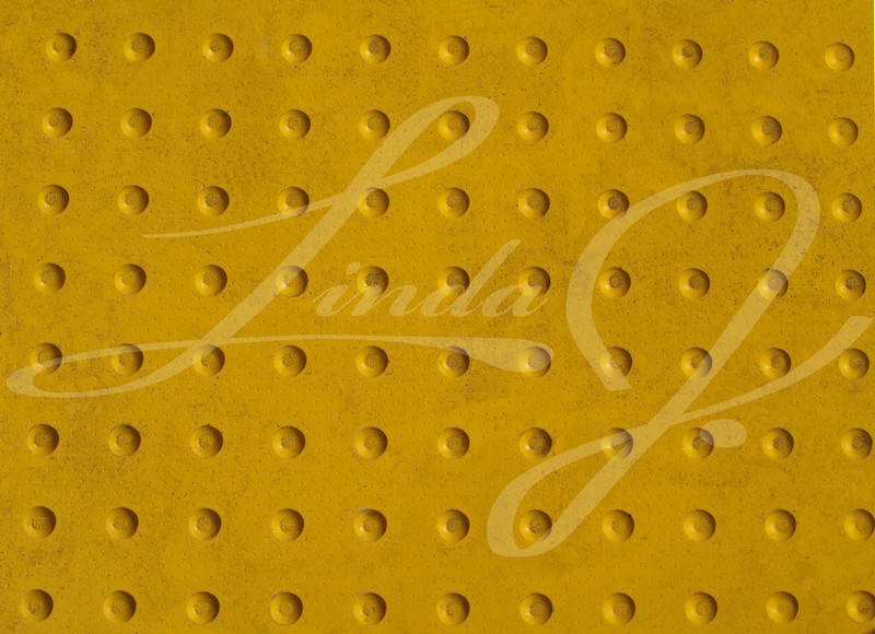 Grunge Yellow Texture of a Non-slip Pattern on a Sidewalk