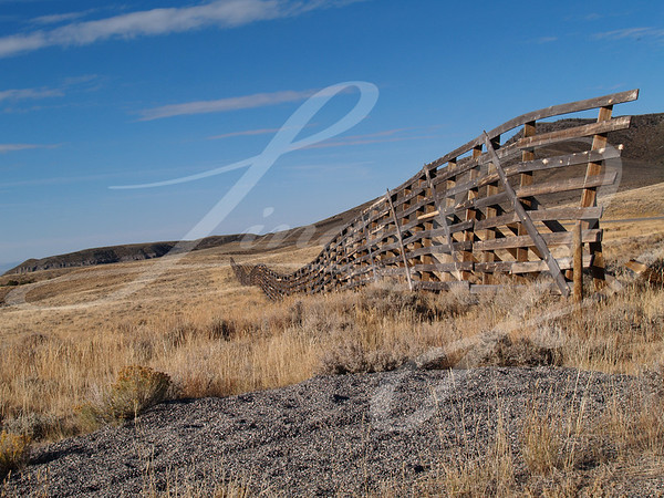 Weather worn snow fence on the prairie in Wyoming
