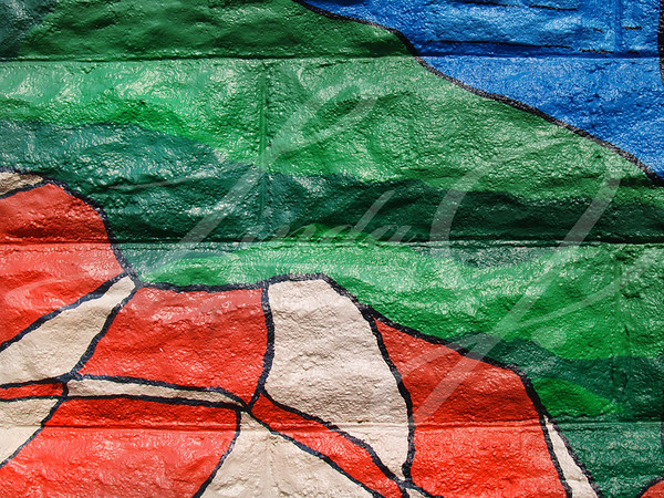 Close-up of colorful graffiti in shades of green, blue and orange that can be used as a background, taken from a public building in Carmel, Indiana.