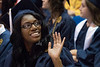 WVU Regents graduate Joydell Sims waves to her family at the WVU College of Education and Human Services commencement. May 13, 2017 at the WVU Coliseum. Photo Greg Ellis