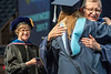 WVU President E. Gordon Gee embraces a student in coagulations as EHS Dean Gypsy M. Denzine smiles, at the WVU College of Education and Human Services commencement. May 13, 2017 at the WVU Coliseum. Photo Greg Ellis