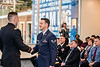 Second Lieutenant Kyle Wall graduating with a bachelor of science in electrical engineering shakes hands with his brother Senior Airman Justin Wall after his first salute during the ARMY ROTC Commissioning ceremony in the Mountaineer Room of the Mountainlair December 14th, 2017.  Photo Brian Persinger