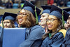 WVU Pathologists assistants Dominique Johnson and Chestia Long listens to speakers at the WVU commencement December 15, 2017. Photo Greg Ellis