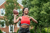 Samira Conteh American Studies and English literature major from London England try's her hand at American Football while attending  the WVU international student body  picnic, on the Lair green August 11, 2017. Photo Greg Ellis