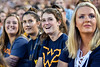 Morgan Pendleton, second from right, smiles as she and other members of the class of 2021 watch a video on the big board during Monday Night Lights.