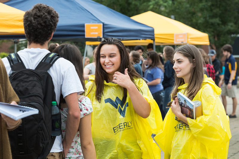 WVU Freshmen Cneyenne Woods Psychology Bridgeport WV and Sydney Selden Psychology Beckley WV talks with friends  at the Academic Session on the Mountainlair Green  August 14, 2017. Photo Greg Ellis
