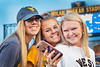 Incoming Freshmen students ( L to R) Caroline Cassedy Sports Management, Reston VA, Brittany Huynn Business, Parkersburg WV, Quinn Burwell Business, Parkersburg WV, make new friends and enjoy the night at  Monday Night Lights Puskar stadium August 14, 2017. Photo Greg Ellis