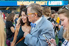 WVU President E. Gordon Gee hugs and chats with  Freshmen Kate Kyak Forensic Science Baltimore MD. Incoming Freshmen students make new friends and enjoy the night at Puskar stadium Monday Night Lights August 14, 2017. Photo Greg Ellis