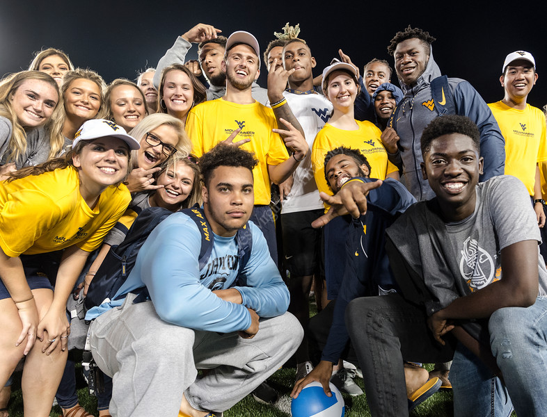 WVU Freshmen students come togeather making new friends and enjoying the evening at Monday Night Lights Puskar stadium August 14, 2017. Photo Greg Ellis