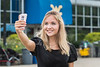 Ekaterina Frolova Journalism major from Moscow Russia skypts with friends in Saint Petersburg Russia while attending the  WVU international student body picnic on the Lair green August 11, 2017. Photo Greg