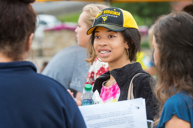 WVU Freshmen Christen Rose Bio Chemistry Pittsburgh PA  chats with new friends  at the Academic Session on the Mountainlair Green  August 14, 2017. Photo Greg Ellis