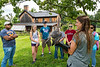 WVU incoming freshmen students participated in a day of service at the Animal Human Bond - Ridgedale Educational Farm Cheat Lake WV. Students listen  to Katie Fallon of the Avian Conservation Center of Appalachia, as she talks about her Artic Falcon, Tundra,  August 8, 2017. Photo Greg Ellis