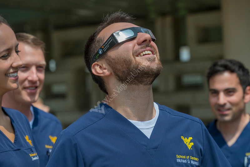 WVU Density student Michael Marmora with classmate observes the partial Solar Eclipse on the Health Science campus August  2017. Photo Greg Ellis