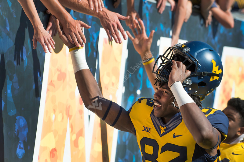 Dominique Maiden high-fives fans after the game against Texas Tech at Milan Puskar Stadium Oct. 14, 2017. The Mountaineers came from behind in the second half to win in the second biggest comeback in WVU football history.