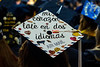 "Cheryl Romine a Spanish Major shares her passion for language at the  Eberly College of Arts and Science and the John Chambers College of Business and Economics December 2018 Commencement at the WVU Coliseum. Cap translation, ""My heart beats in two languages"", December 12, 2018. Photo Greg Ellis"