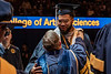 WVU Athlete Braylin Farris shares a moment with WVU President E. Gordon Gee at the Eberly College of Arts and Science and the John Chambers College of Business and Economics December 2018 Commencement at the WVU Coliseum , December 12, 2018. Photo Greg Ellis
