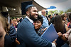 WVU Eberly College Graduate Criminology, Jamal Kallay hugs his mother Florence wishing her Happy Mother's Day at the Eberly College Bachelor Commencement May 13, 2018. Photo Greg Ellis