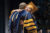 A WVU Eberly College Graduates embraces President E. Gordon Gee at the Eberly College Bachelor Commencement May 13, 2018. Photo Greg Ellis