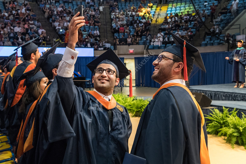 WVU Masters of Industrial Engineering graduates Hussien Alahmad and Mohammed Alghamid make a celebration selfie at the Benjamin M. Statler College of Engineering and Mineral Resources Commencement May 12, 2018. Photo Greg Ellis