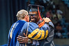 WVU graduates Ya-Ya Salin  Safety Management And Industrial Hygiene smiles and shares a hug with WVU President E. Gordon Gee at the Benjamin M. Statler College of Engineering and Mineral Resources Commencement May 12, 2018. Photo Greg Ellis