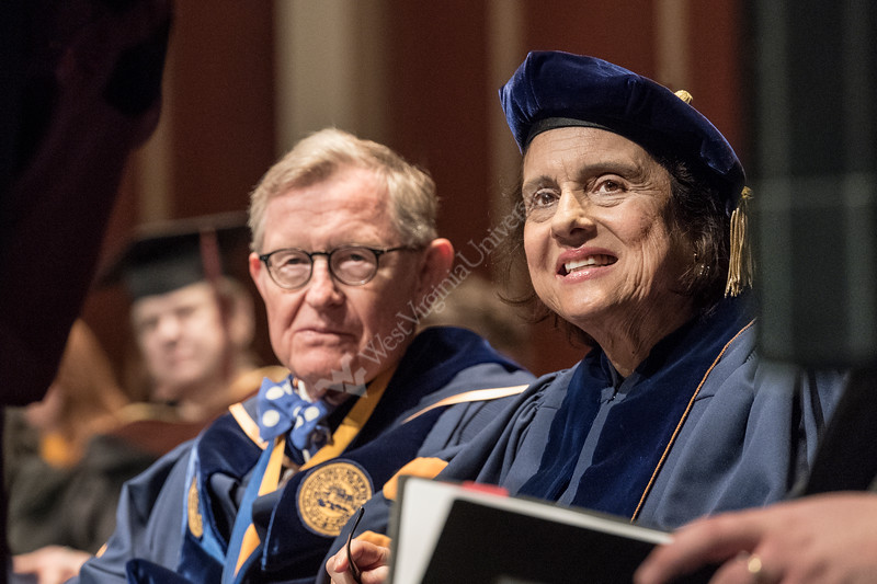 """Eve Lee daughter of Maestro Everett Lee, the first African American to conduct a major Broadway production, """"On the Town,"""" with an integrated cast and all-white pit orchestra in 1945 looks on with WVU President E. Gordon Gee after receiving her father's  Honorary Doctorate Degree from the WVU College of Creative Arts May 5, 2018. Photo Greg Ellis"""