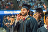 "WVU Eberly College Graduate Anas Alkanderi, Biology from Kuwait speaks to his parents in Kuwait by phone telling them"" I love you all so much and I hope I make you proud."" at the Eberly College Bachelor Commencement May 13, 2018. Photo Greg Ellis"