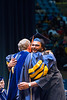 Graduating Senior Ankur Kumar hugs President Gee just before receiving his degree in Industrial Engineering on May 12, 2018.