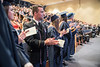 Dana Jason Dandeneau celebrates as classmates receive diplomas as the School of Public Health holds their Commencement at the Health Sciences Center April 11th, 2018.  Photo Brian Persinger
