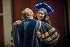 WVU Creative Arts Graduate Katherine Waugh BAF Design Tech shares a glowing Mortarboard and a hug with WVU President E. Gordon Gee at the CAC graduation May 11, 2018. Photo Greg Ellis