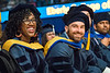 WVU Eberly Graduate students Tyler Davis and Stephen Raso  PhD Philosophy Chemistry react to the speaker Ann Stuart  Pancake at the Eberly College Graduate Commencement May 13, 2018. Photo Greg Ellis