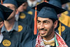 WVU graduate Yousuf Altoubi listens to WVU President E. Gordon Gee address his class  at the Benjamin M. Statler College of Engineering and Mineral Resources Commencement May 12, 2018. Photo Greg Ellis