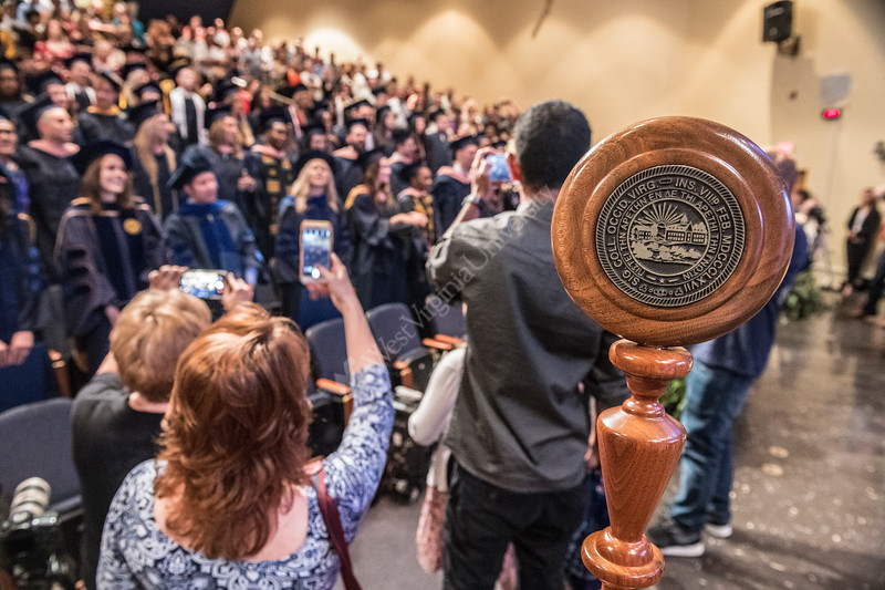 Families photograph graduates as Country Roads is played following the School of Public Health Commencement at the Health Sciences Center April 11th, 2018.  Photo Brian Persinger